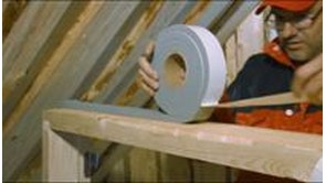 Installation of log house windows with self-expanding tape
